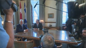 Couillard and Legault transfer power