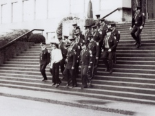 Michael Jackson walks with the New Westminster police officers down the steps of city hall in 1984. (New Westminster Museum and Archives)