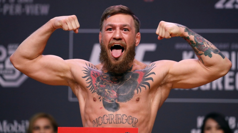 Conor McGregor poses during a ceremonial weigh-in for the UFC 229 mixed martial arts fight Friday, Oct. 5, 2018, in Las Vegas. (AP Photo/John Locher)