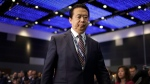 In this July 4, 2017 file photo, then-Interpol President, Meng Hongwei, walks toward the stage to deliver his opening address at the Interpol World congress in Singapore. (AP Photo/Wong Maye-E, File)