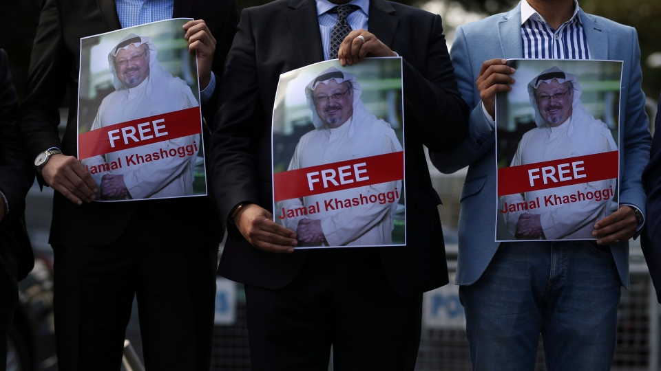 Holding pictures of missing Saudi writer Jamal Khashoggi, people gather in his support, near the Saudi Arabia consulate in Istanbul, Friday, Oct. 5, 2018. (AP Photo/Emrah Gurel)