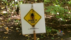 A warning sign to beware of ticks in Ottawa.