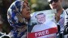 Holding a picture of missing Saudi writer Jamal Khashoggi, Tawakkol Karman, of Yemen the Nobel Peace Prize laureate for 2011, talks to members of the media near the Saudi Arabia consulate in Istanbul, Friday, Oct. 5, 2018. Khashoggi, a 59-year-old veteran journalist who has lived in self-imposed exile in the U.S. since Prince Mohammed's rise to power, disappeared Oct. 2 while on a visit to the consulate to get paperwork done to be married to his Turkish fiancee. (AP Photo/Emrah Gurel)