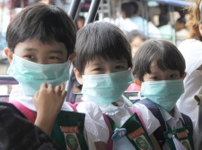School children wear face masks as they line up to enter a classroom in Rangoon, Burma on Tuesday, June 30, 2009. (AP / Khin Maung Win)