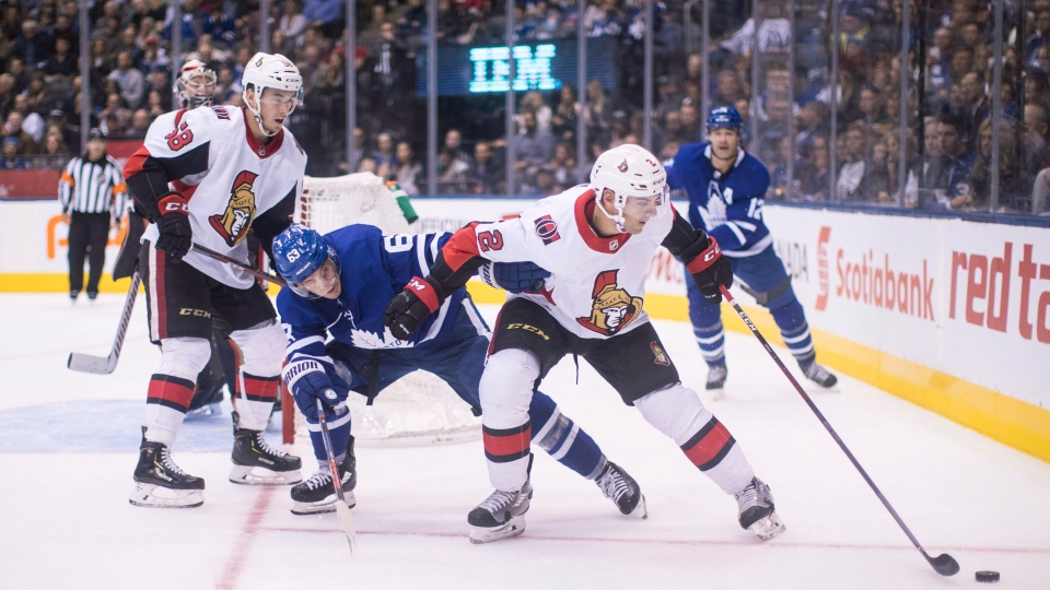 Ottawa Senators' Dylan DeMelo (2) holds off Toronto Maple Leafs' Tyler Ennis (63) during second period NHL hockey action in Toronto on Saturday, Oct. 6, 2018. (THE CANADIAN PRESS/Chris Young)