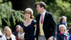 In this Saturday, May 20, 2017 photo, Britain's Princess Eugenie and Jack Brooksbank arrive for the wedding of Pippa Middleton and James Matthews at St Mark's Church in Englefield, England. (AP Photo/Kirsty Wigglesworth, File)