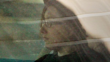 Terri-Lynne McClintic, left, is transported from court for proceedings in the Michael Rafferty murder trial in London, Ontario, Friday, March, 16, 2012. THE CANADIAN PRESS/Dave Chidley