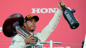 Race winner Mercedes driver Lewis Hamilton celebrates on the podium after winning the Japanese Formula One Grand Prix at the Suzuka Circuit in Suzuka, central Japan, Sunday, Oct. 7, 2018. (AP Photo/Ng Han Guan)