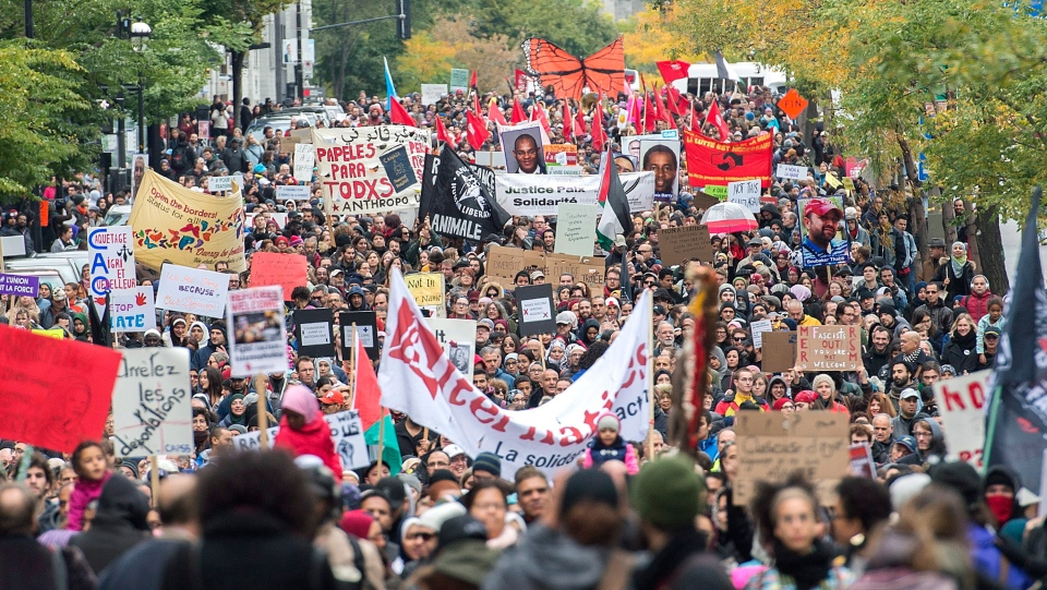 People take part in a demonstration against racism in Montreal, Sunday, October 7, 2018. (THE CANADIAN PRESS/Graham Hughes)