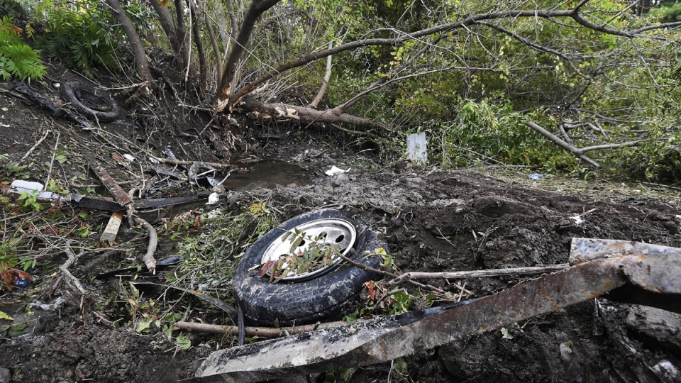 Debris scatters the site of a fatal crash in Schoharie, N.Y., on Oct. 7, 2018.  (Hans Pennink / AP)
