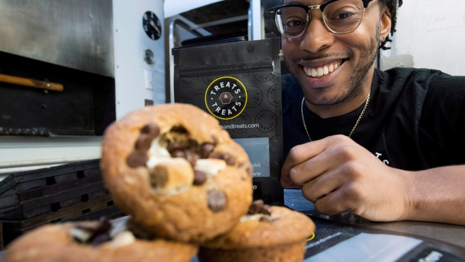 Yannick Craigwell shows off some of his edible marijuana baked treats in Vancouver, Wednesday, Oct. 3, 2018. THE CANADIAN PRESS Jonathan Hayward