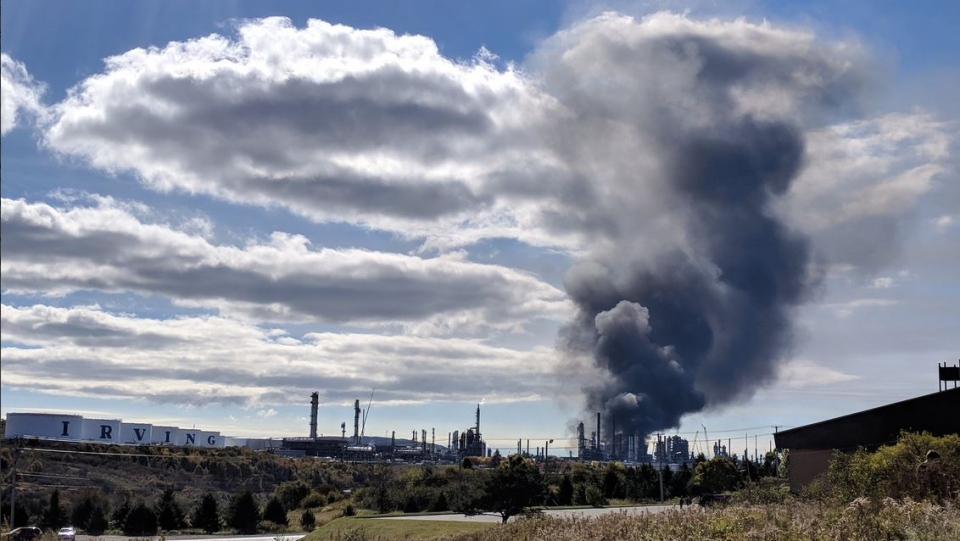 Plumes of black smoke rise from a fire at the Irving Oil refinery in Saint John. There were several reports of an explosion at approximately 10:15 a.m. on Monday morning. (LAURA LYALL CTV)