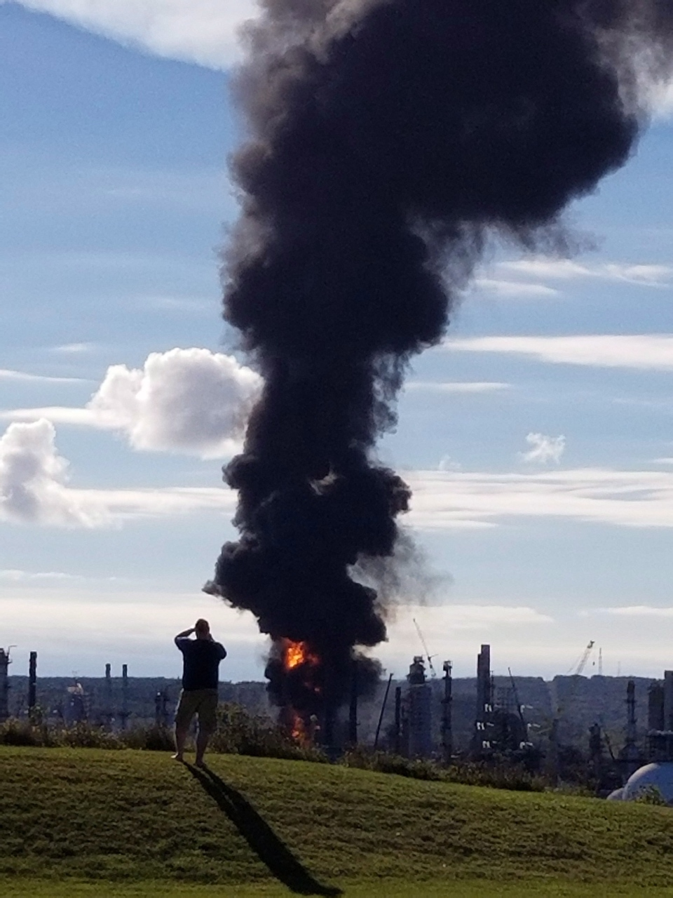 A fire and plume of smoke rises from an Irving Oil refinery following reports of an explosion in Saint John, N.B., on Monday, October 8, 2018. (THE CANADIAN PRESS/HO - Nate Guimond)