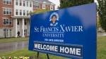 A sign marks one of the entrances to the St. Francis Xavier University campus in Antigonish, N.S. on Friday, Sept. 28, 2018. (THE CANADIAN PRESS/Andrew Vaughan)