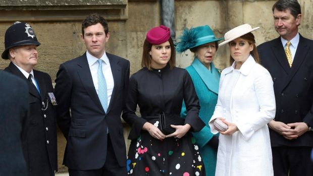 From second left, Jack Brooksbank and Princess Eugenie, Princess Anne, Princess Beatrice and Timothy Laurence arrive for the Easter Mattins Service at St. George's Chapel, Windsor Castle, in Windsor, England, Sunday, April 1, 2018. (Simon Dawson/Pool Photo via AP)