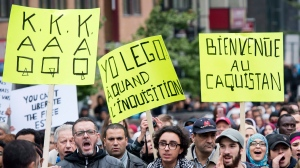 People take part in a demonstration against racism in Montreal, Sunday, October 7, 2018. THE CANADIAN PRESS/Graham Hughes