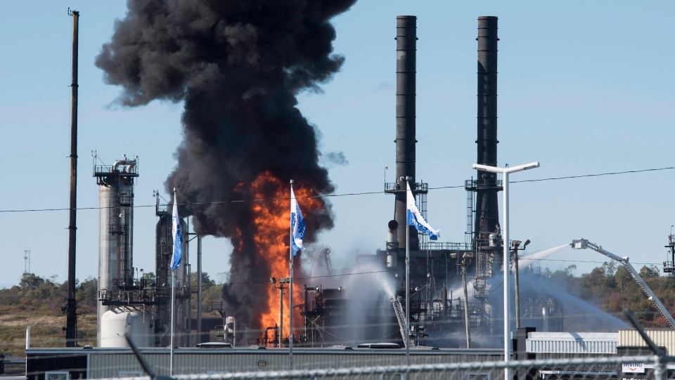 Flame and smoke erupts from the Irving Oil refinery in Saint John, N.B., on Monday, September 8, 2018. (THE CANADIAN PRESS/Stephen MacGillivray)
