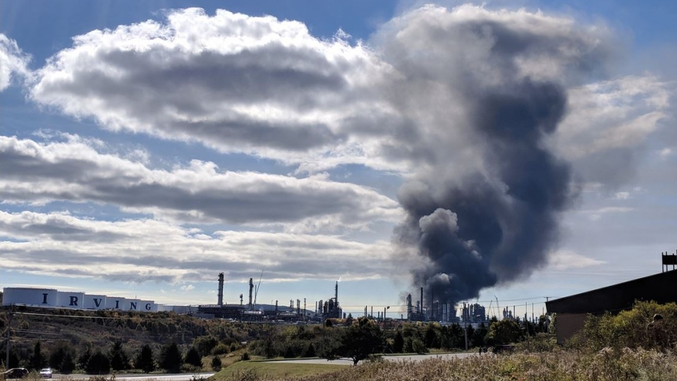 Plumes of black smoke rise from a fire at the Irving Oil refinery in Saint John. There were several reports of an explosion at approximately 10:15 a.m. on Oct. 8, 2018. (Laura Lyall/CTV)
