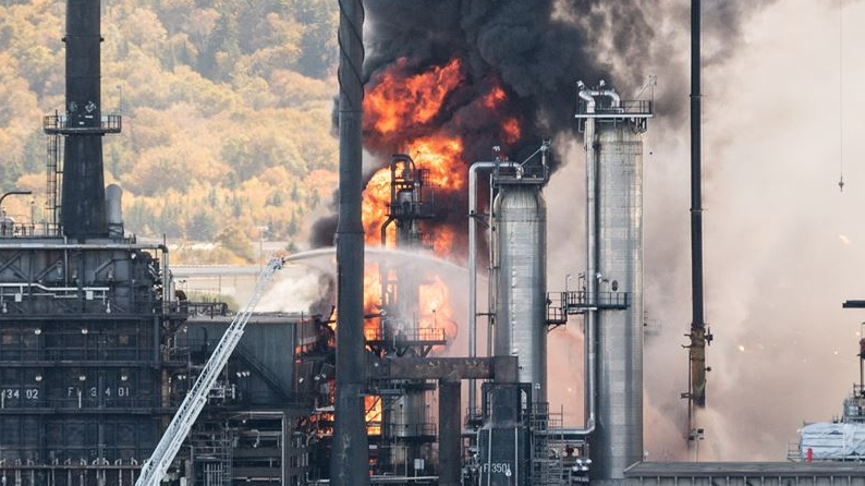 Smoke billows from the Irving Oil refinery in Saint John, N.B., after a fire broke out on Monday. (COURTESY JOE COMEAU)