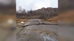 A damaged road is seen in Old Fort, B.C.