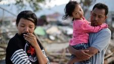 Survivors of Indonesia quake and tsunami
