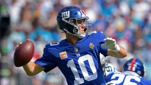 New York Giants' Eli Manning (10) looks to pass against the Carolina Panthers in the first half of an NFL football game in Charlotte, N.C., Sunday, Oct. 7, 2018. (AP Photo/Mike McCarn)
