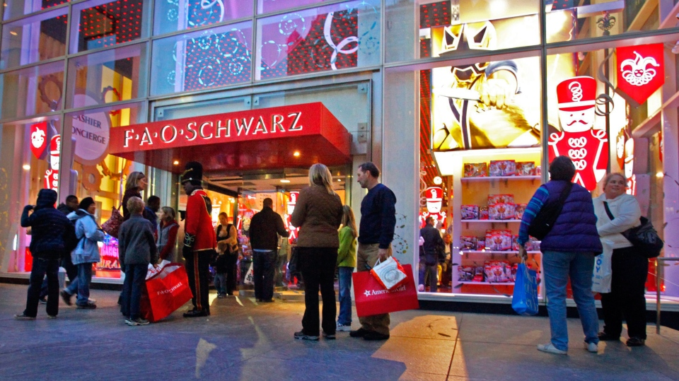 In this Nov. 21, 2011, file photo, shoppers are seen outside of FAO Schwarz in New York. (AP Photo/Bebeto Matthews, File)