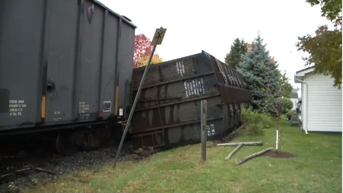 The two toppled train cars that crashed through Jim Clark's garden and part of his back yard just after ten o'clock Tuesday morning were carrying carbon black, which is used in the manufacturing of tires.