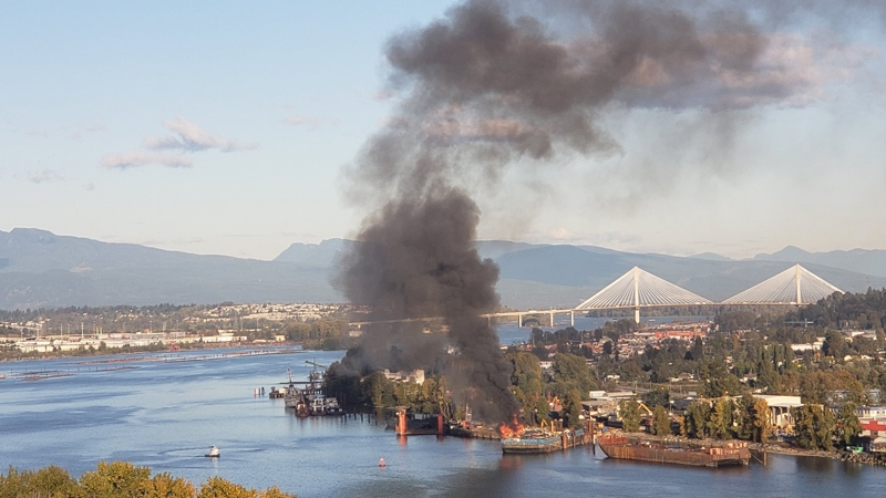 A photo from Twitter user @ShanVonD shows smoke rising from a barge in Surrey, B.C. on Tuesday, Oct. 9, 2018.