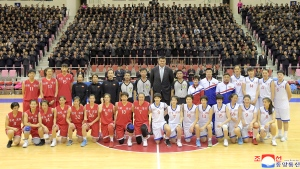 In this Tuesday, Oct. 9, 2018, photo provided on Wednesday, Oct. 10, 2018, by the North Korean government, Chinese hoop legend Yao Ming, center rear, poses for a group photo with Chinese and North Korean basketball players after their friendly match in Pyongyang, North Korea. (Korean Central News Agency/Korea News Service via AP)