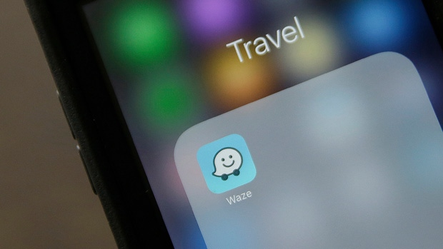 Waze application is displayed on a smartphone