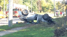 A vehicle on its roof after a crash