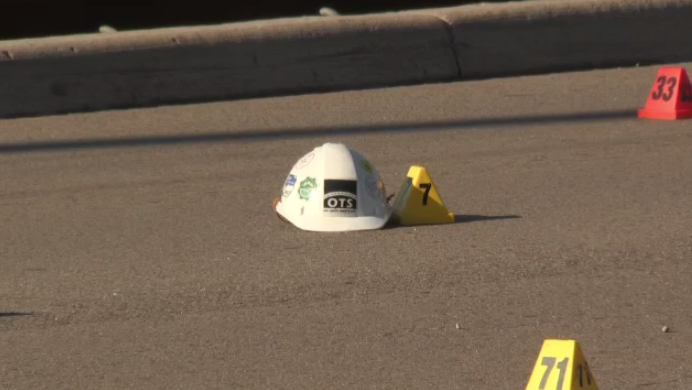 A hard hat seen at the scene of a car crash