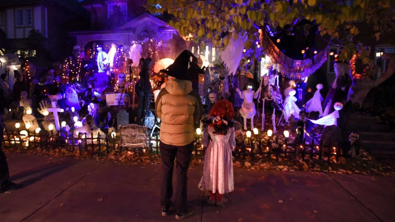 "Children trick-or-treat in Ottawa on Halloween, Monday, Oct. 31, 2016. The gleefully shouted phrase of ""trick or treat"" that children use when they call on houses at Halloween is getting a healthier response in cities across Canada..THE CANADIAN PRESS/Justin Tang"