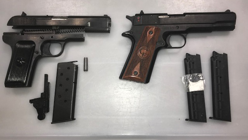 RCMP seized two guns at the Edmonton International Airport after a flyer tried to take them on the plane.