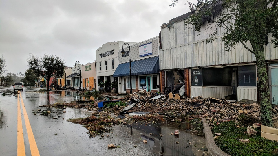 Port St. Joe Lodge number 111, at right, lays in ruins on Reid Avenue on Wednesday, Oct. 10, 2018, in Port St. Joe, Fla., after Hurricane Michael made landfall in the Florida Panhandle. (Douglas R. Clifford / The Tampa Bay Times via AP)