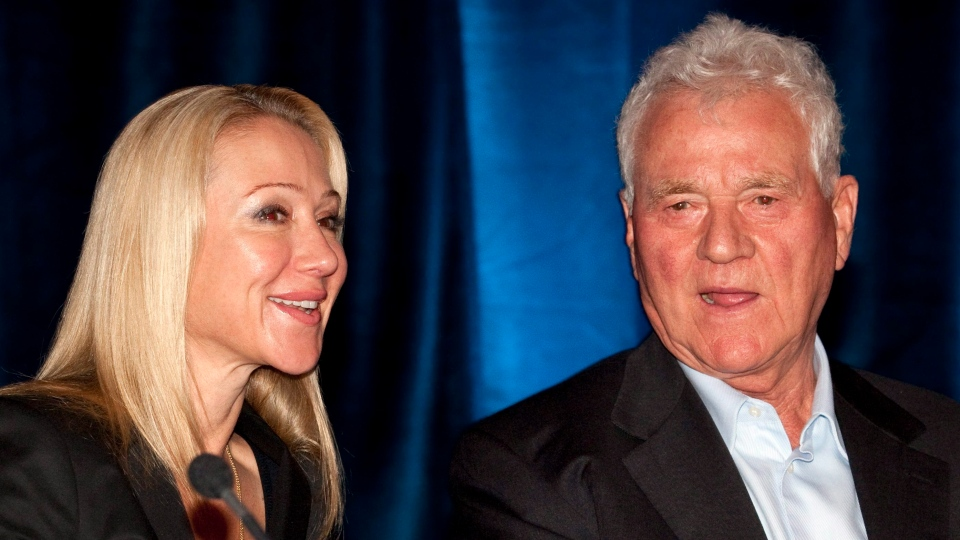 Frank and Belinda Stronach chat at Magna International Inc. annual general meeting in Markham, Ontario on Thursday May 6, 2010. (THE CANADIAN PRESS/Frank Gunn)
