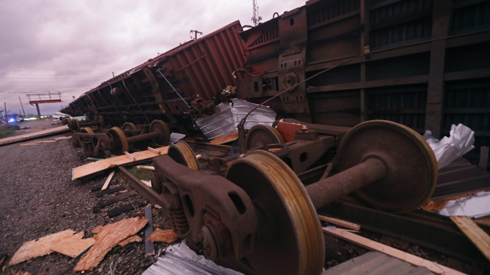 Derailed box cars are seen in the aftermath of Hurricane Michael in Panama City, Fla., Wednesday, Oct. 10, 2018. (AP Photo/Gerald Herbert)