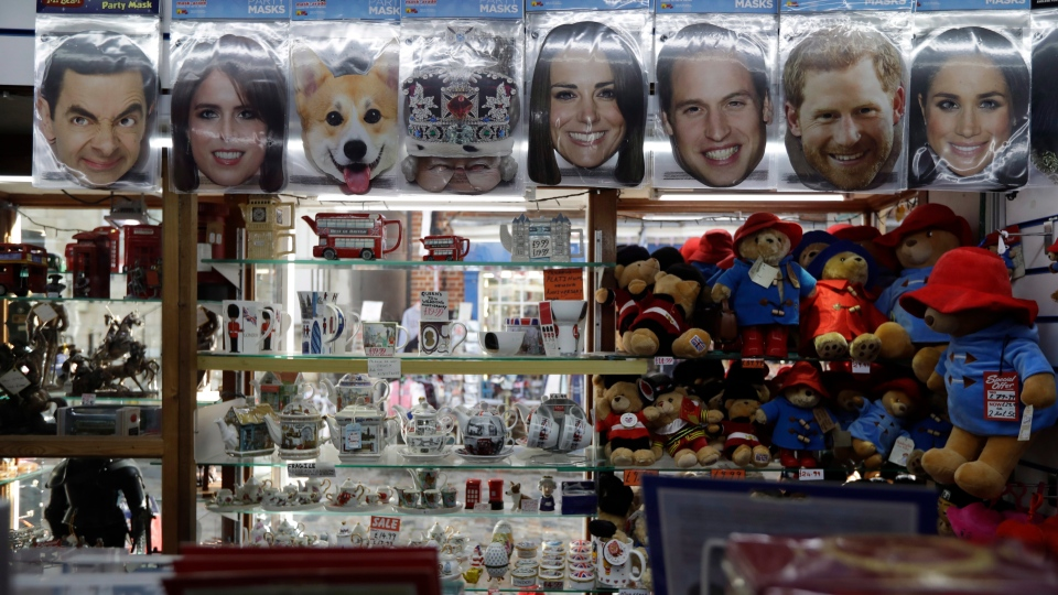 A Princess Eugenie mask, second left, is displayed for sale with other masks in a souvenir shop ahead of the wedding of Princess Eugenie in Windsor, England, Wednesday, Oct. 10, 2018. (AP Photo/Matt Dunham)