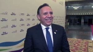 Quebec Premier-Designate Francois Legault talks to reporters at La Francophonie summit in Armenia on Oct. 11, 2018