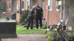 Police search outside apartment building