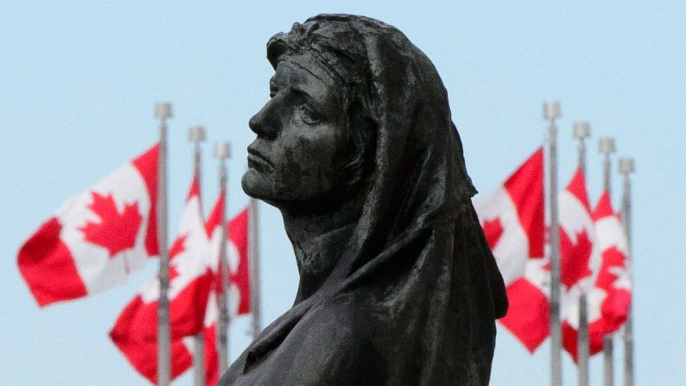 The statue of Veritas (Truth) is shown in front of the Supreme Court of Canada in Ottawa on Wednesday, May 23, 2018. (THE CANADIAN PRESS / Sean Kilpatrick)