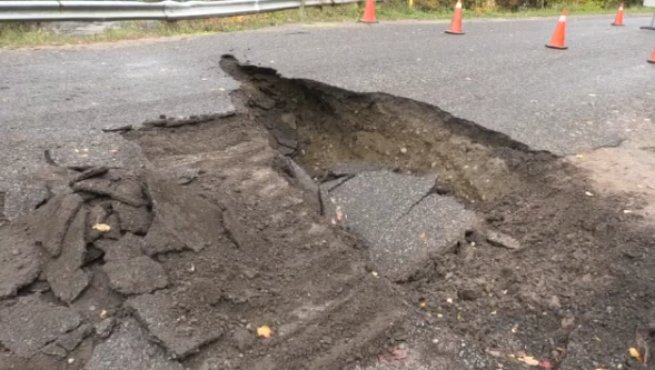 Road washout closes roads after heavy rain