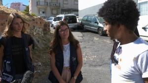 Harm reduction workers speak with drug user Caesar Moreno in Lisbon, Portugal.