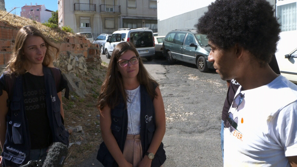 Harm reduction workers speak with drug user Caesar Moreno in Lisbon, Portugal.