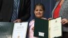 Janaya Chekowski-McKenzie accepts her honorary high school diploma.