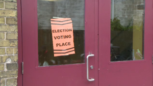 An election sign on a door
