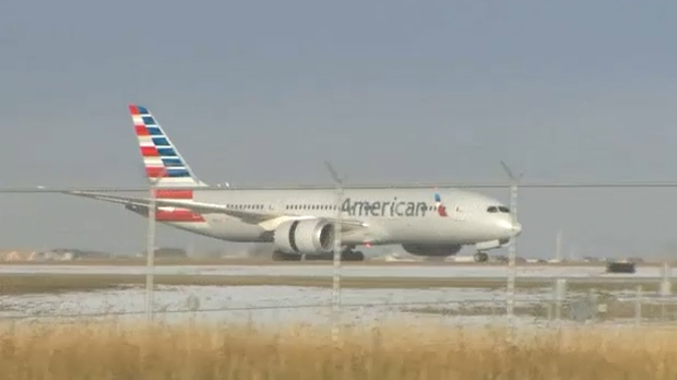 An American Airlines Boeing 787-8 Dreamliner on the runway at Calgary International Airport after making an emergency landing on flight from Dallas-Fort Worth to Beijing