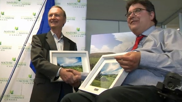 Stan Carscallen and Kent Hehr, Calgary-Centre MP, at Thursday's Nature Conservancy of Canada announcement regarding Carscallen's White Moose Ranch