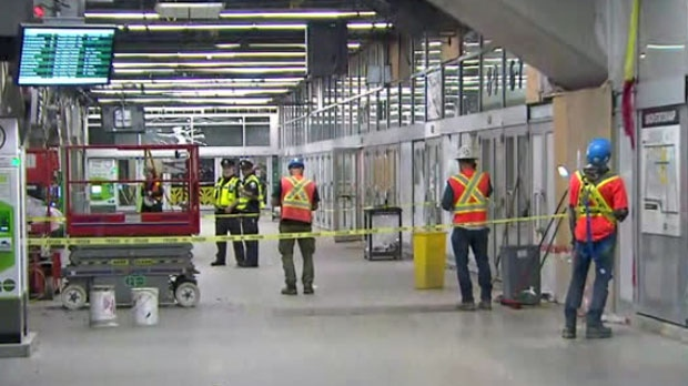 Crews are seen repairing a portion of Union Station after a woman was injured on Thursday.